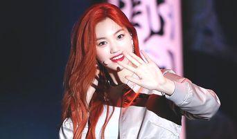 Weki Meki's DoYeon Appears With Fiery Reddish-Orange Hair, Says Comeback Is Happening Soon