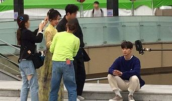 """BTOB's Yook SungJae Spotted Filming For His Upcoming Drama """"Ssanggap Pocha"""" With Hwang JungEum"""