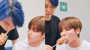 TXT's YeonJun Cutely Shares A Bite Of Corndog With TaeHyun During V-Live