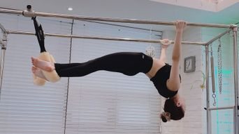 IZ*ONE's EunBi Shows Off Her Healthy Figure During Pilates Class