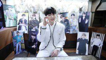 BTS's Suga Snaps A Photo With 10 Of His Miniature Banners
