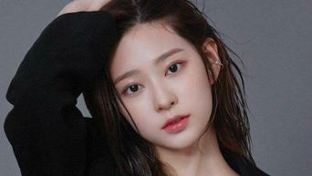 Netizens See A Hint Of IZ*ONE Kim MinJu In This E-Sports Announcer's Visuals